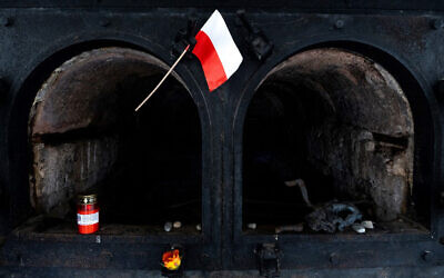 A Polish flag displayed in front of a former crematorium oven at the Gusen concentration camp in Austria, January 20, 2020. (Joe Klamar/AFP)