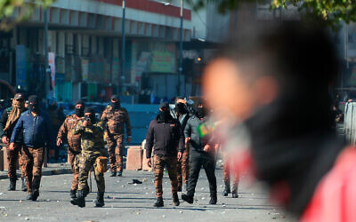Iraqi security forces try to disperse anti-government protesters during clashes in downtown Baghdad, Iraq, Jan. 27, 2020. (AP/Hadi Mizban)