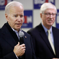 Democratic presidential candidate Joe Biden speaks alongside Iowa attorney general Tom Miller during a stop at a campaign field office in Des Moines, Iowa, January 13, 2020. (AP/Patrick Semansky)