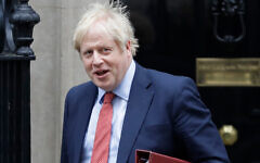 Britain's Prime Minister Boris Johnson leaves 10 Downing Street to attend the weekly session of Prime Ministers Questions in Parliament in London, Jan. 22, 2020. (AP/Kirsty Wigglesworth)
