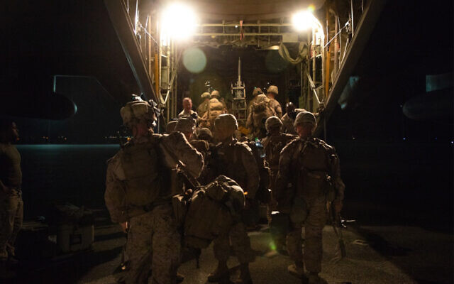 US Marines load a C-130 plane to reinforce the Baghdad Embassy Compound in Iraq, Dec. 31, 2019. (US Marine Corps/Sgt. Kyle C. Talbot)