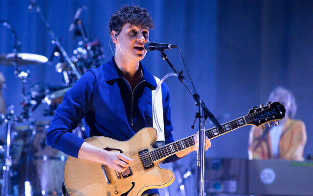 """Ezra Koenig of the band Vampire Weekend performs in concert during the group's """"Father of the Bride Tour"""" in Philadelphia, Pennsylvania, September 4, 2019 (Owen Sweeney/Invision/AP)"""