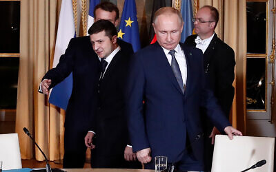 Russian President Vladimir Putin, right, and Ukrainian President Volodymyr Zelensky arrive for a working session at the Elysee Palace, December 9, 2019 in Paris. (Ian Langsdon/Pool via AP)