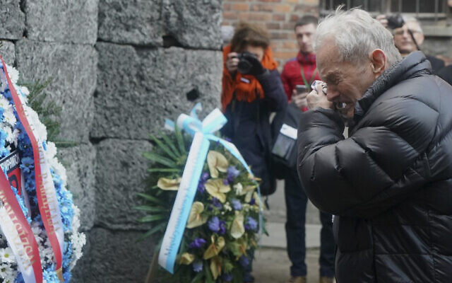 A Holocaust survivor cries as he pays his respect at the death wall at the memorial site of the former German Nazi death camp Auschwitz during ceremonies to commemorate the 75th anniversary of the camp's liberation in Oswiecim, Poland, January 27, 2020. (JANEK SKARZYNSKI/AFP)
