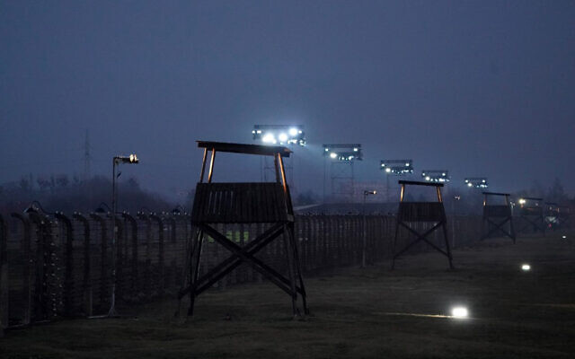 A picture taken on January 27, 2020 shows the barbed wire fence enclosing the memorial site of the former German Nazi death camp Auschwitz during the ceremonies to commemorate the 75th anniversary of the camp's liberation in Oswiecim, Poland. (JANEK SKARZYNSKI/AFP)