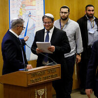 Itamar Ben Gvir, head of the Otzma Yehudit party presents his party list to the Central Elections committee at the Knesset in Jerusalem, January 15, 2020. (Olivier Fitoussi/Flash90)