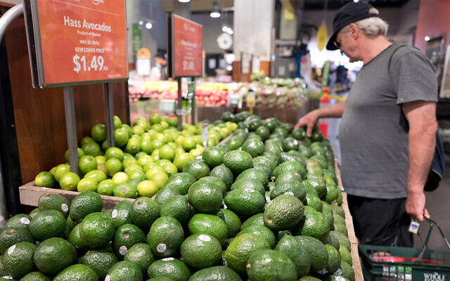 Illustrative: A man shops for avocados at a Whole Foods Market in New York, August 28, 2017. (AP/Mark Lennihan)