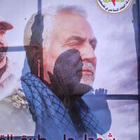 Palestinians walk next to posters of Qassem Soleimani in Gaza City, January 4, 2020. (Hassan Jedi/Flash90)