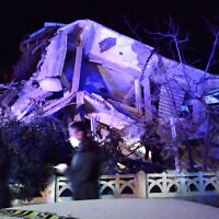 Turkish officials and police arrive at the scene of a collapsed building following a 6.8 magnitude earthquake in Elazig, eastern Turkey, January 24, 2020. (DHA/Demiroren News Agency (DHA)/AFP)