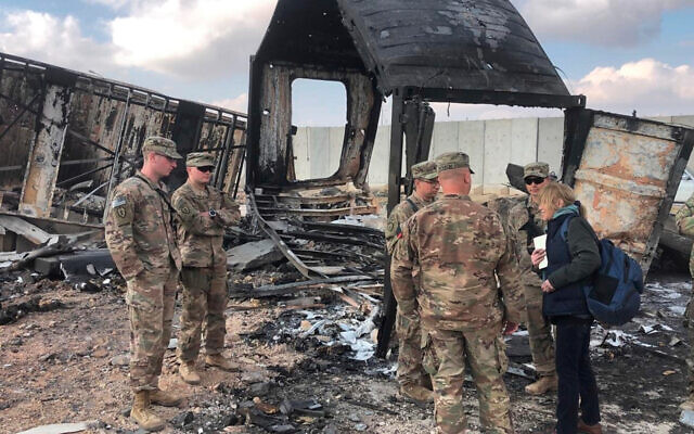 US soldiers stand amid damage at a site of Iranian bombing at Ain al-Asad air base, in Anbar, Iraq, January 13, 2020. (AP/Qassim Abdul-Zahra)