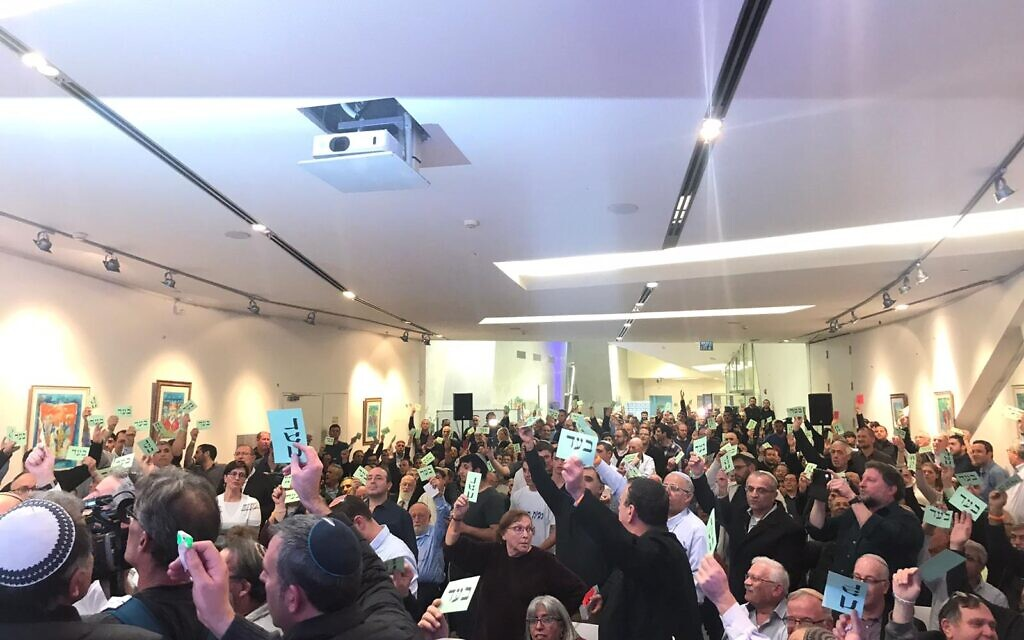 Jewish Home central committee members vote to approve a merger with the far-right Otzma Yehudit party on January 13, 2020 (courtesy)