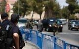 Illustrative. A police officer stands guard at a road block in Jerusalem in an undated photograph. (Israel Police)