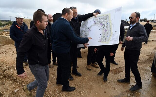 Then-Defense Minister Naftali Bennett (C) visits the Beit El settlement on January 21, 2020. (Ariel Hermoni/Defense Ministry)