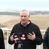 Blue and White chairman Benny Gantz (C) speaks to reporters during a visit to the Jordan Valley on January 21, 2020. (Elad Malka/Blue and White)
