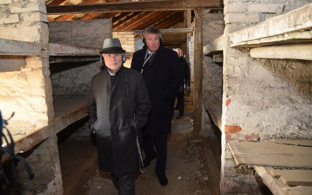 Members of the EJA delegation walk through the barracks in Birkenau known as the 'death barracks,' where women were sent when they were close to death, January 21, 2020. (Yoni Rykner/ EJA)