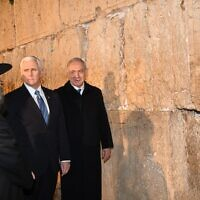 US Vice President Mike Pence, accompanied by PM Netanyahu visit the Western Wall in Jerusalem's Old City, January 23, 2020 (Amos Ben Gershom/GPO)