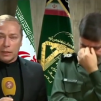 A spokesman for Iran's Revolutionary Guards (right) is seen weeping after announcing the death of top general Qassem Soleimani, January 3, 2020 (MEMRI screenshot)