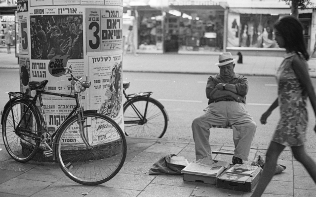 Selling newspapers on Dizengoff Boulevard, from 'Emerging from the Shadows' exhibit at Beit Avi Chai, through June 2020 (Courtesy Sarah Ayal)