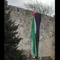 A Palestinian flag hung from the walls of Jerusalem's Old City on January 1, 2020. (screen capture: Twitter)