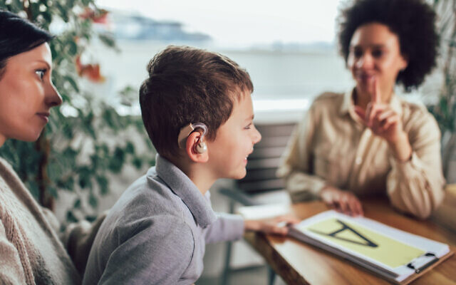 Illustrative image of a deaf boy learning sign language (Jovanmandic; iStock by Getty Images)