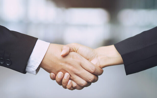 Illustrative image of a handshake (Rattankun Thongbun, iStock by Getty Images)