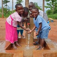 Children in Africa benefit from safe drinking water thanks to Israeli technology brought to them via nonprofit Innovation Africa. (courtesy)