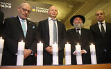Israeli Ambassador to Ukraine Joel Lion, left, , and other dignitaries commemorate the Holocaust at the Ukrainian parliament, January 16, 2020. (The Assembly of Nationalities of Ukraine via JTA)