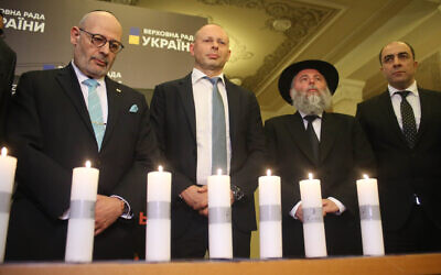 Israeli Ambassador to Ukraine Joel Lion, left, and other dignitaries commemorate the Holocaust at the Ukrainian parliament, January 16, 2020. (The Assembly of Nationalities of Ukraine via JTA)