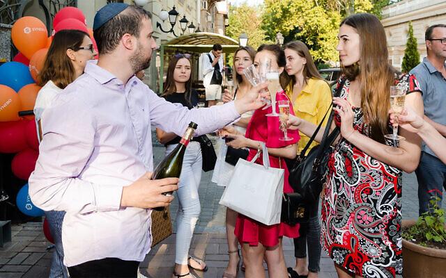 Patrons of Kosher Bar toasting outside the establishment in Odessa, Sept. 1, 2019. (Courtesy of Kosher Bar via JTA)