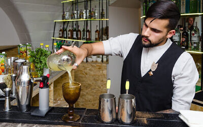 A bartender prepares a cocktail at Kosher Bar in Odessa, Ukraine, Sept. 25, 2019. (Courtesy of Kosher Bar via JTA)