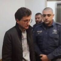Michael Nikolkin appears at Tel Aviv District Court, accused of stabbing to death his half-brother Evgeny Kleinman, January 2, 2020 (Screen grab via Channel 12)