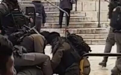 Border Police officers restrain a woman said to have attempted to carry out a stabbing attack at Jerusalem Old City's Damascus Gate, January 18, 2020 (Screen grab via Twitter)