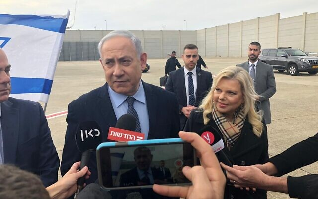 Prime Minister Benjamin Netanyahu speaks with media before flying to Greece to sign a major natural gas supply deal, January 2, 2019. (Shalom Yerushalmi/Times of Israel)