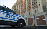 Illustrative: An NYPD vehicles sits outside the Metropolitan Detention Center in Brooklyn, February 4, 2019. (Drew Angerer/Getty Images via JTA)