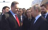 Foreign Minister Israel Katz greets Russian President Vladimir Putin at Ben Gurion Airport ahead of the World Holocaust Forum, January 23, 2020 (Screen capture/Israel Airports Authority)