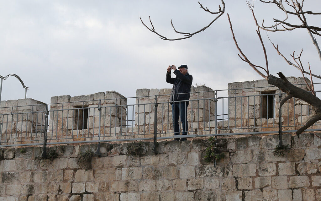 A visitor on a newly-opened section of Jerusalem's Old City ramparts. (Shmuel Bar-Am)
