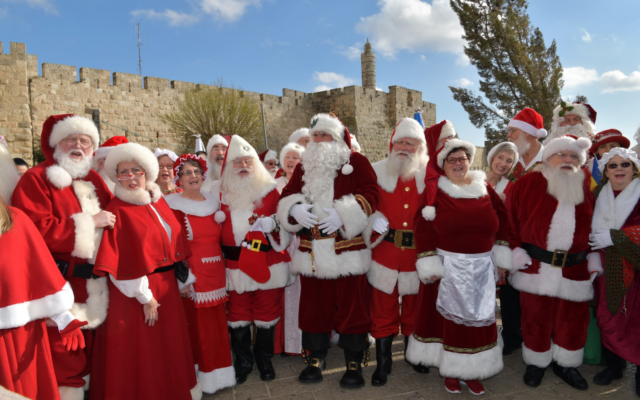 Some of 47 Santas and Mrs. Clauses visiting Jerusalem in January 2020 on a Ministry of Tourism trip (Courtesy Israel Ministry of Tourism)