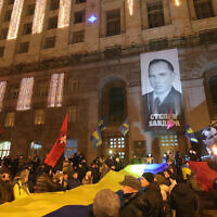 Marchers rally outside the Kyiv City State Administration during the torchlight procession of honor, dignity and freedom on the 111th birthday anniversary of OUN-B (Organization of Ukrainian Nationalists) leader Stepan Bandera, Kyiv, January 1, 2020 (Pavlo_Bagmut/ Ukrinform / Barcroft Media via Getty Images, JTA)