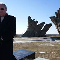 File: Nazi-hunter Efraim Zuroff saying Kaddish, a mourning prayer, for Holocaust victims near Kaunas, Lithuania, Feb. 15, 2015. (Cnaan Liphshiz/JTA)