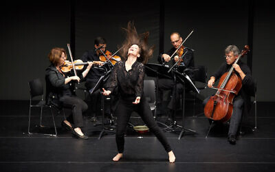 Renana Raz onstage performing one of her works (Courtesy Winnie Yeung)