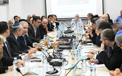 Prime Minister Benjamin Netanyahu, center left, speaks during a situational assessment at the Health Ministry in Jerusalem, February 23, 2020 (Amos Ben Gershom/GPO)