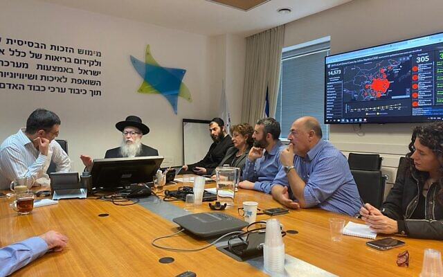 Health Minister Yaakov Litzman (2L) and Health Ministry officials during a meeting on the threat of the Chinese coronavirus, at the Health Ministry in Jerusalem, February 2, 2020. (Health Ministry/courtesy)