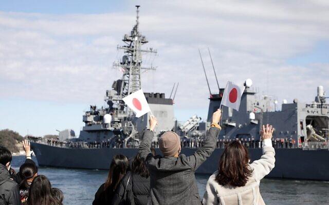 "People wave as Japan's Maritime Self-Defense Force destroyer ""Takanami"" leaves for the Middle East at Yokosuka Naval Base in Yokosuka, Kanagawa prefecture on February 2, 2020. (Photo by STR / JIJI PRESS / AFP)"