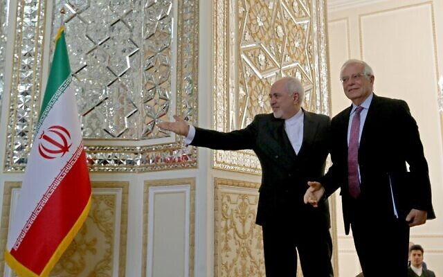 Iran's Foreign Minister Mohammad Javad Zarif (L) welcomes European Union High Representative for Foreign Affairs and Security Policy Josep Borrell in the capital Tehran on February 3, 2020 . (Photo by ATTA KENARE / AFP)