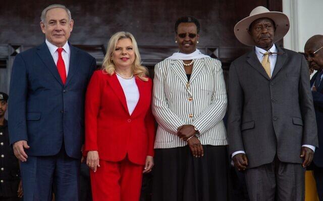 Ugandan President Yoweri Museveni (R) and Uganda's First Lady Janet Museveni (2nd-R) pose for photo with Prime Minister Benjamin Netanyahu and his wife Sara Netanyahu at the State House in Entebbe, Uganda, February 3, 2020. (Sumy Sadurni/AFP)