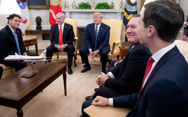 US President Donald Trump (center) meets with Israeli Prime Minister Benjamin Netanyahu (second from left) alongside Israeli Ambassador to the US Ron Dermer (left), US Vice President Mike Pence, US Secretary of State Mike Pompeo (2nd right) and White House adviser Jared Kushner (right) in the Oval Office of the White House on January 27, 2020 (SAUL LOEB / AFP)