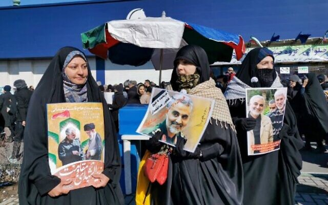 Iranian women carry a portrait of slain Iranian General Qasem Soleimani, on the 40th day of his killing in a US drone strike,  during commemorations marking 41 years since the Islamic Revolution, in the capital Tehran on February 11, 2020 (Atta KENARE / AFP)
