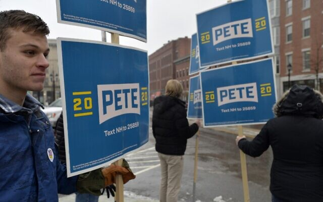 Supporters of US presidential candidate Pete Buttigieg stand outside the State House during the New Hampshire primary in Concord, New Hampshire on February 11, 2020. (Joseph Prezioso/AFP)