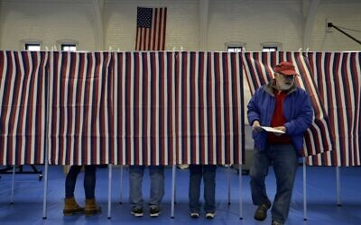 Voters cast their ballots at the Ward Five Community Center during the New Hampshire primary in Concord, New Hampshire on February 11, 2020. (Joseph Prezioso/AFP)