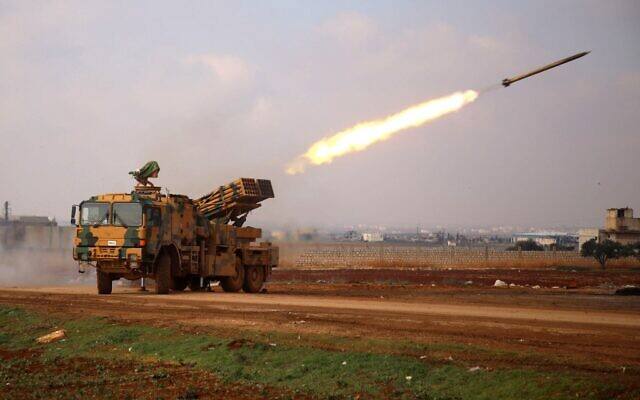A Turkish mobile rocket launcher fires from a position near the village of Miznaz, on the western outskirts of Syria's Aleppo province, on February 14, 2020. (Aaref Watad/AFP)